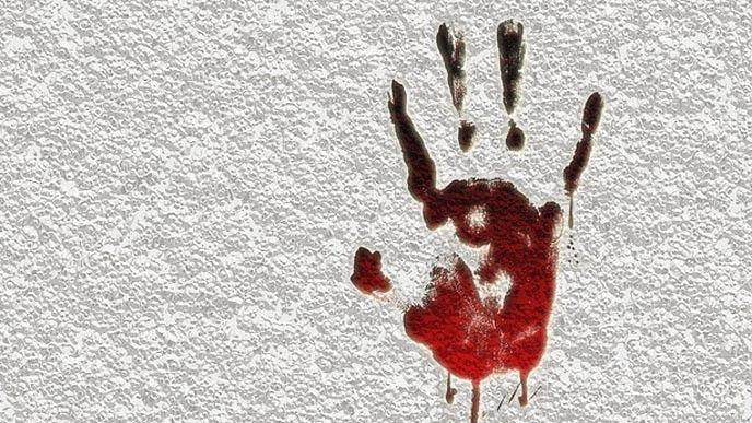 Blodigt handavtryck