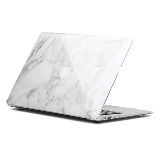 Laptopskal i mönster som efterliknar vit marmor