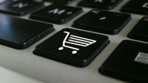 Tangentbord med shoppingknapp